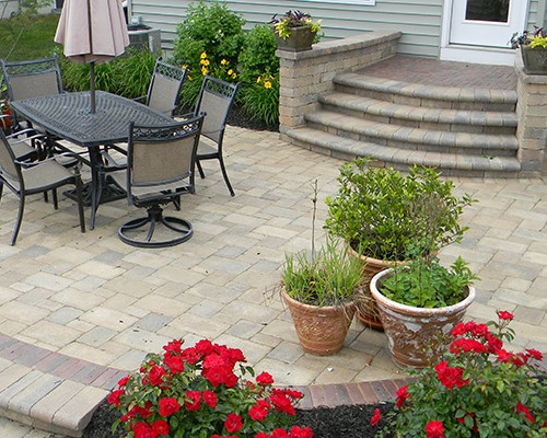 Paver Patio Surrounded By Beautiful Landscaping