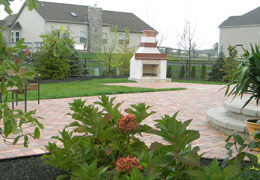 Outdoor Fireplace is Focal Point of Paver Patio