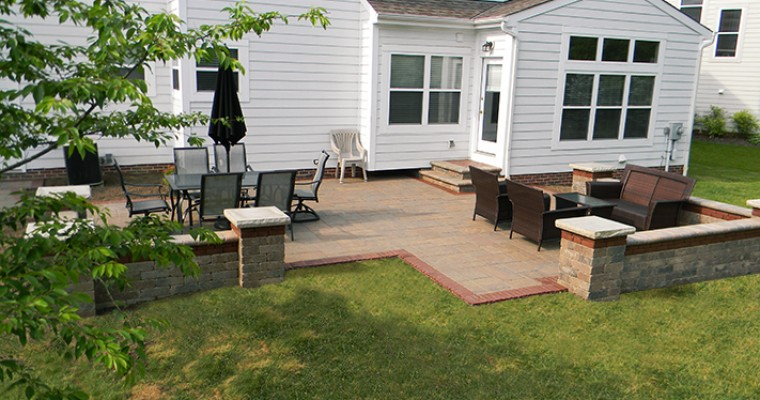 Stone Paver Patio With Accent Band, Seating Walls And LED Outdoor Lighting