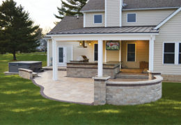 Covered Outdoor Kitchen with TV and Stone Patio