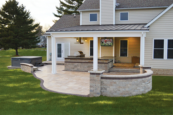 Covered Outdoor Kitchen with TV and Stone Patio - Landscaping ...