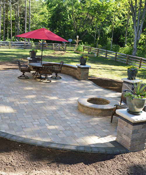 Rounded Stone Patio with Conversational Firepit